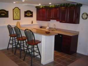 Basement remodeling often includes installing a bar