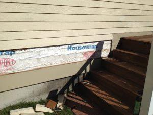 Installing clapboard siding onto house