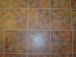 Setting bathroom ceramic tile floor.