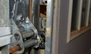 Garage door maintenance includes inspecting the garage door track roller