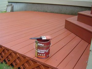 Deck staining using a 4 inch brush.