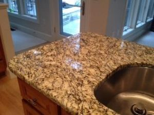 Installing granite countertops as part of a kitchen makeover project.