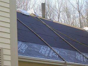 Notice the asphalt roof felt paper and ice and watershield installed on the roof prior to actually shingling the roof.