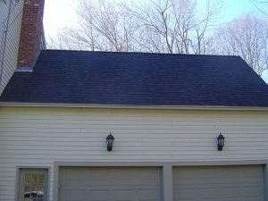 Asphalt shingle roof installation. Here are architectural shingles being installed.
