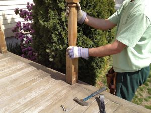 removing old deck railing posts.