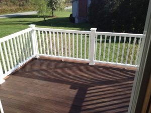 Second side of composite deck railing installed.