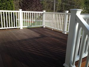 All sides of composite deck railing installed.