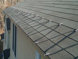 Use deicing heat cables to eliminate roof ice dams