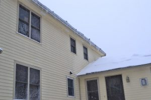 Ice melt socks can be seen at the edge of the upper roof in this picture.