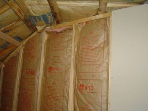 Insulating walls between garage and main house to keep the house warmer.