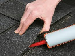 Flat shingle roof repair using roofing cement.