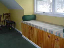 Here I installed beadboard paneling along the base of this window seat.
