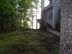 Restoring a Lawn by broadcasting compost and overseeding with grass seed.