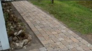 Stone paver walkway prior to installation of bluestone gravel next to it.