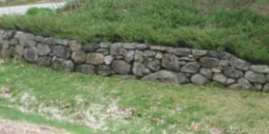 A stone wall made from field picked granite stones.