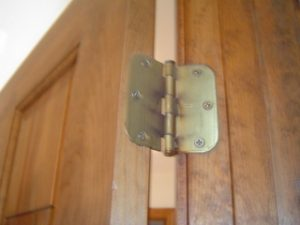 How to remove a door hinge.