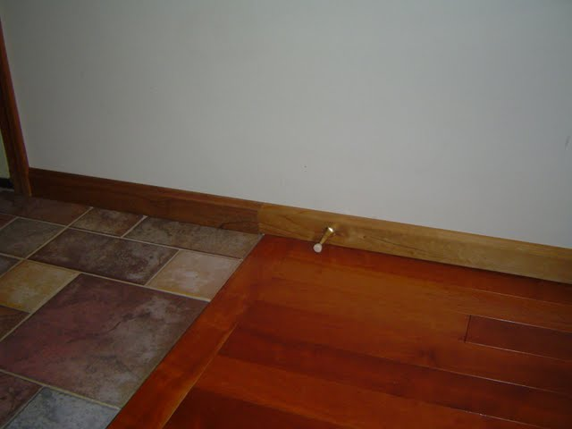 Transitioning baseboard trim from one room to another.