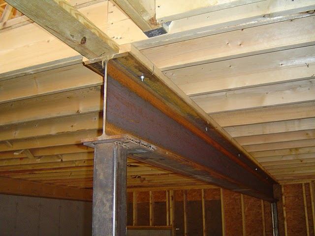 Floor joists supported by a center I-beam.