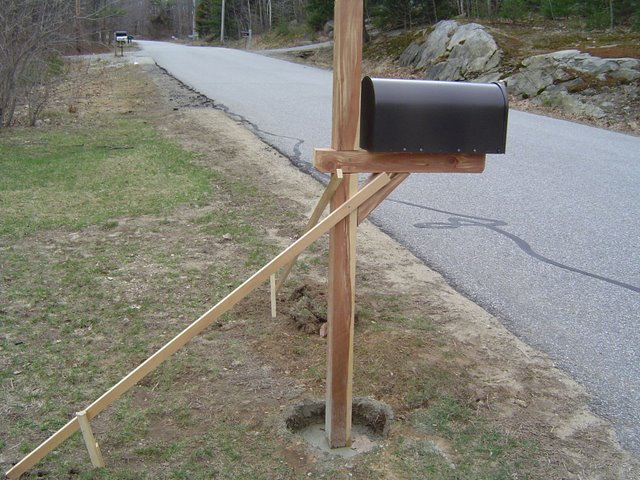 Replace mailbox post in winter