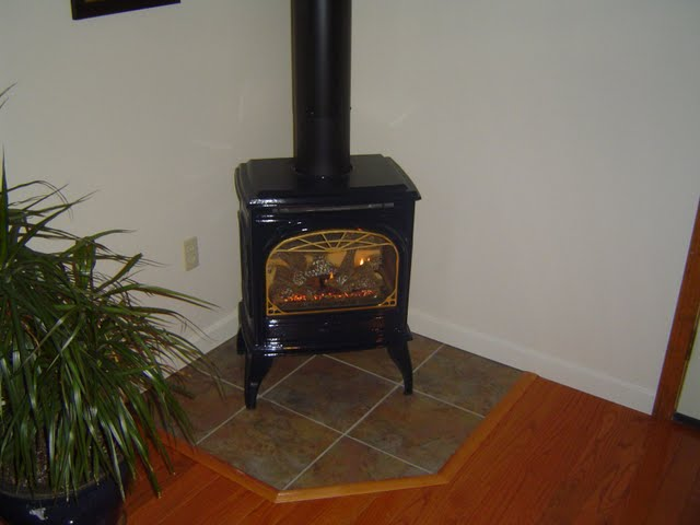 Providing supplementary heating to a home addition with a vented gas stove.