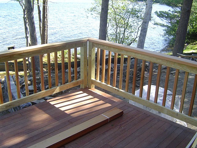 G185 galvanized flashing, stainless steel or PVC flashing should be used when the deck flashing is to be in contact with ACQ treated lumber.