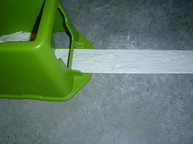 The TapeBuddy applies an even and consistent amount of joint compound to the drywall tape.