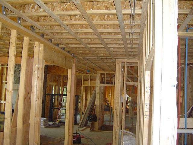Here is a home being framed with traditional 2x4 and 2x6 wood studs.
