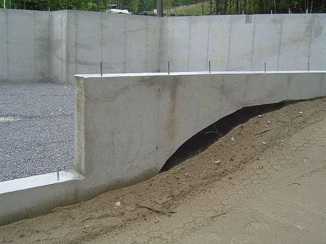 When backfilling foundation walls coarse grain soil should be pushed, rather than dropped, into place.