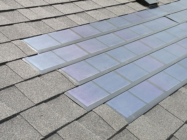 Solar roof shingles integrated into existing asphalt shingled roof.